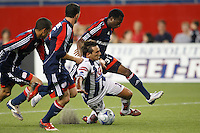 Pachuca CF midfielder Christian Gimenez (19) goes down under pressure from New England Revolution defenders Jay Heaps (6), Amaechi Igwe (2), and midfielder Sainey Nyassi (31). The New England Revolution defeated Pachuca CF 1-0 during a Group B match of the 2008 North American SuperLiga at Gillette Stadium in Foxborough, Massachusetts, on July 16, 2008.