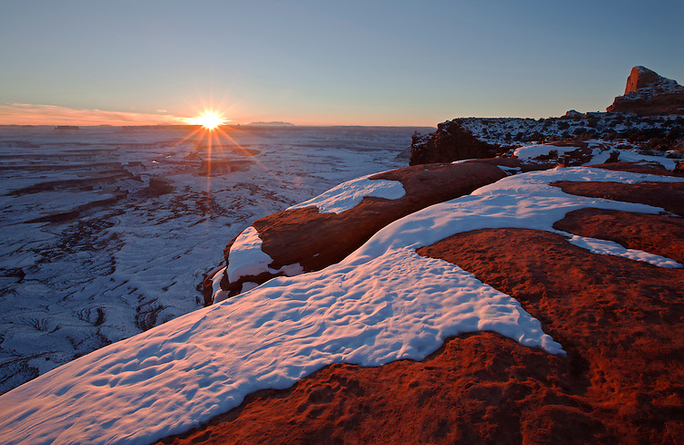 Viewed from the Green River Overlook, the sun sets over Island in the Sky district in Canyonlands National Park, Utah, United States of America