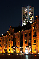 Landmark Tower in Minato Mirai towers over the old red Brick wharehouse (Akarenga Sko) in Yokohama, Japan November 20th 2008