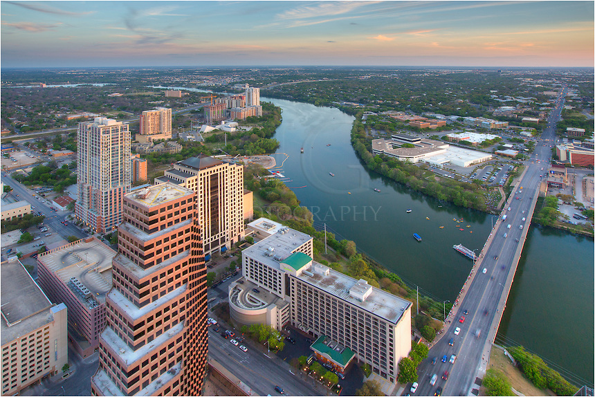 From the highest point in the Austin Skyline, the top of the Austonian affords amazing views. This image of Austin shows Ladybird Lake below, along with the Congress Bridge that spans the lake. In the distance you can see I-35 heading south towards San Antonio. This partial Austin Skyline image shows several buildings along the waterfront, including the Milago Condos and the Shores.