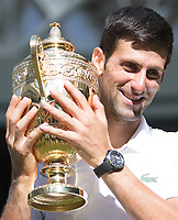 Novak Djokovic (SRB) holds the Wimbledon Gentlemen's singles Trophy,