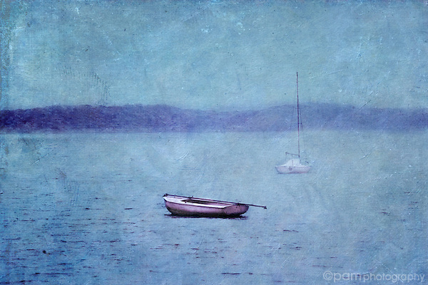Two boats on water in blue