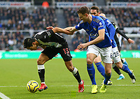 1st January 2020; St James Park, Newcastle, Tyne and Wear, England; English Premier League Football, Newcastle United versus Leicester City; Yoshinori Muto of Newcastle United controls the ball under heavy pressure from Jonny Evans of Leicester City - Strictly Editorial Use Only. No use with unauthorized audio, video, data, fixture lists, club/league logos or 'live' services. Online in-match use limited to 120 images, no video emulation. No use in betting, games or single club/league/player publications
