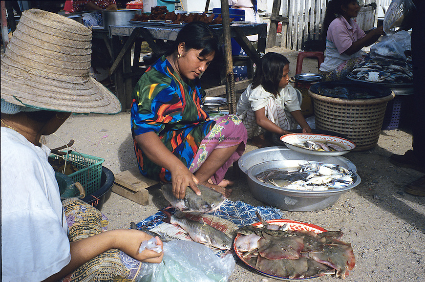 Women selling fish on the market