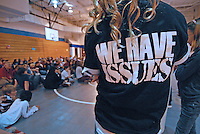 A teenager wears a black t-shirt expressing a youthful attitude as she listens to a speaker at a church youth group meeting in Westerville, Ohio.<br />