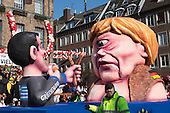 Düsseldorf, Germany. 16 February 2015. A float shows the new Greek government opposing German chanceller Angela Merkel who is depicted as a cyclops.  The traditional Shrove Monday (Rosenmontag) carnival parade takes place in Düsseldorf, Germany. 1.2 million revellers lined the route. The Monday parades went ahead despite increased terror warnings which led to the parade in Brunswick (Braunschweig) being cancelled shortly before it was due to take place.