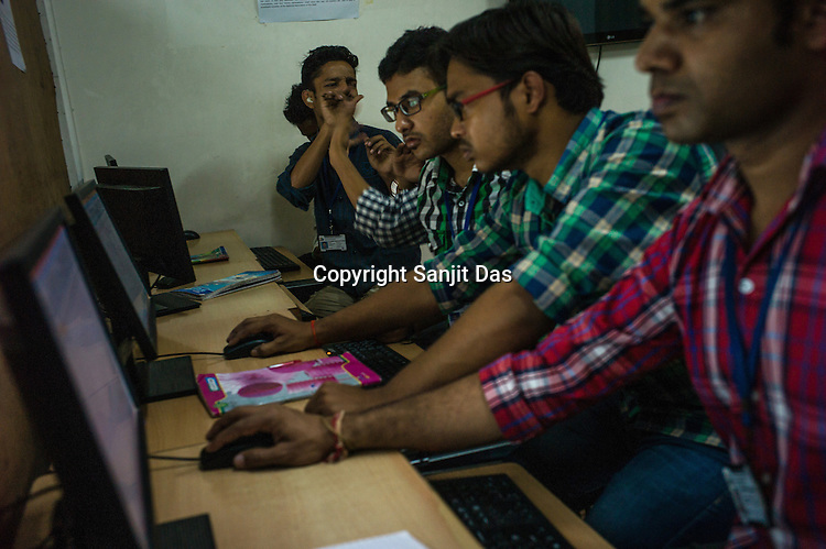 Deaf students sit together to learn how to use a computer in a classroom at the Noida Deaf Society in Noida, Uttar Pradesh, India.