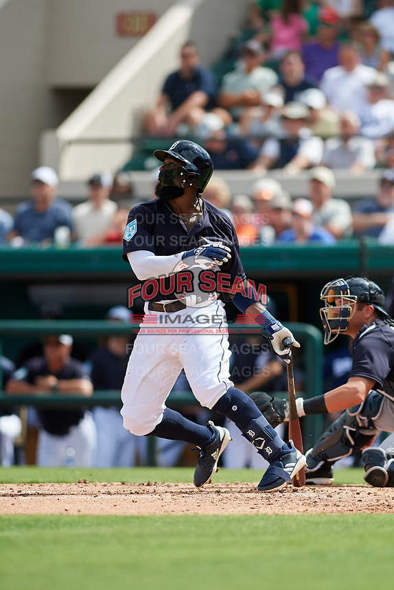 Detroit Tigers second baseman Josh Harrison (1) hits a single during a Grapefruit League Spring Training game against the New York Yankees on February 27, 2019 at Publix Field at Joker Marchant Stadium in Lakeland, Florida.  Yankees defeated the Tigers 10-4 as the game was called after the sixth inning due to rain.  (Mike Janes/Four Seam Images)