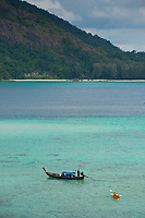 Longtail boat and kayak on Ko Lipe beach, Thailand