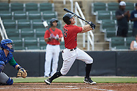 Cameron Simmons (45) of the Kannapolis Intimidators follows through on his swing against the Lexington Legends at Kannapolis Intimidators Stadium on August 4, 2019 in Kannapolis, North Carolina. The Legends defeated the Intimidators 5-1. (Brian Westerholt/Four Seam Images)