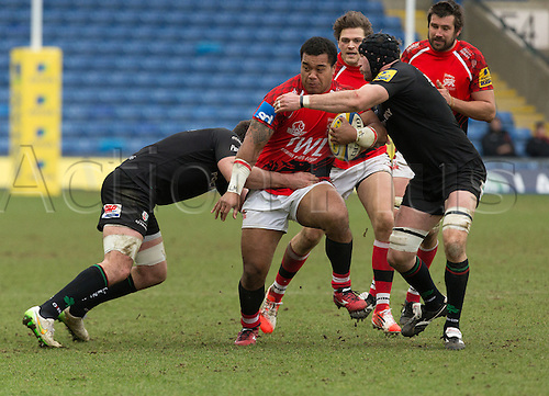 28.02.2015.  Oxford, England.  Aviva Premiership. London Welsh versus London Irish.   Taione Vea is wrapped up by the two london Irish defenders Tom Guest (l) and George Skivington (Captain).