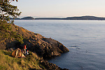 Couple, sea kayak camping, Strawberry Island, San Juan Islands, Puget Sound, Salish Sea, Washington State, U.S.A., Washington State Department of Natural Resources, Cypress Island Natural Resources Conservation Area,.model released,.