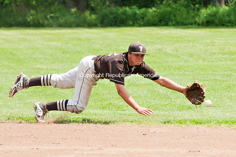 THOMASTON, CT-3 June 2014-060314EC08-  Thomaston's Anthony Moura dives for the ball but falls short against the base hit from St. Paul. The Bears won at home, 7-3, in the second round of the Class S tournament Tuesday in Thomaston. Erin Covey Republican-American