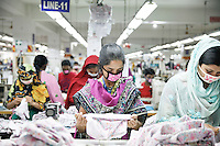Bangladeshi female workers work at a garments factory in gazipur, near Dhaka, Bnagladesh