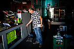 Joe Riofrio in his closed store, the Westside Grocery in Mendota, Calif., September 10, 2012.