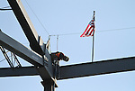 SIOUX FALLS, SD - OCTOBER 16:  A construction worker places the last beam in the Denny Sanford Event Center that will enclose the building.  (Photo by Dave Eggen/Inertia)