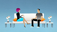 Man and woman on couch talking