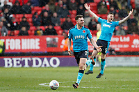 Lewis Coyle of Fleetwood Town is stopped by the whistle of referee, Mark Heywood during the Sky Bet League 1 match between Charlton Athletic and Fleetwood Town at The Valley, London, England on 17 March 2018. Photo by Carlton Myrie.