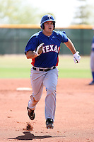 Brett Nicholas #10 of the Texas Rangers plays in an extended spring training game against the Los Angeles Dodgers at the Rangers minor league complex on May 7, 2011  in Surprise, Arizona. .Photo by:  Bill Mitchell/Four Seam Images.