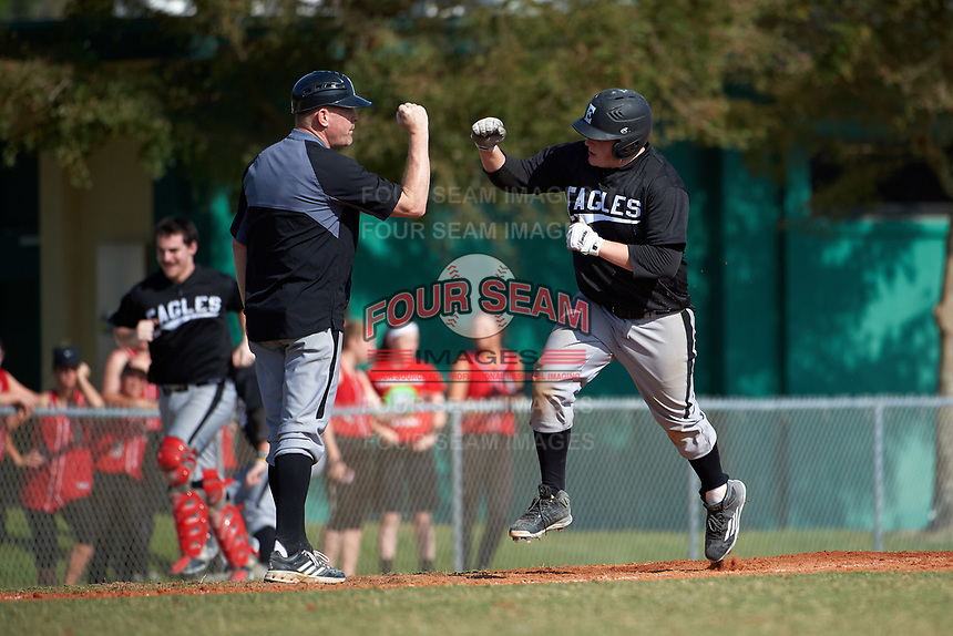 Edgewood Eagles head coach Al Brisack congratulates Nick Lehner (36) after hitting a home run during the first game of a doubleheader against the Lasell Lasers on April 14, 2016 at Terry Park in Fort Myers, Florida.  Edgewood defeated Lasell 9-7.  (Mike Janes/Four Seam Images)