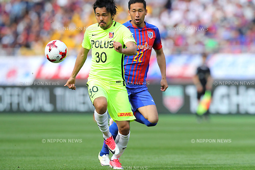 (L-R) <br /> Shinzo Koroki (Reds), <br /> Yuhei Tokunaga (FC Tokyo), <br /> APRIL 16, 2017 - Football / Soccer : <br /> 2017 J1 League match between F.C. Tokyo 0-1 Urawa Reds <br /> at Ajinomoto Stadium, Tokyo, Japan. <br /> (Photo by AFLO SPORT)
