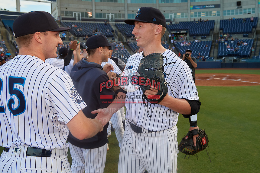 Tampa Tarpons pitcher Trevor Stephan (35) shakes hands with teammates, including Kyle Zurak (25), after closing out a Florida State League game against the Jupiter Hammerheads on July 26, 2019 at George M. Steinbrenner Field in Tampa, Florida.  Stephan struck out 9 batters over 7 innings for a no-hitter in the first game of a doubleheader.  Tampa defeated Jupiter 2-0.  (Mike Janes/Four Seam Images)