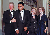 First Family poses for a photo with Muhammad Ali at the White House Millennium Dinner in Washington, D.C. on 31 December, 1999.  (L-R) United States President Bill Clinton, Former Heavyweight Champion Muhammad Ali, First Lady Hillary Rodham Clinton, and Chelsea Clinton.<br /> Credit: Ron Sachs / CNP