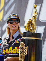 Sep 18, 2016; Concord, NC, USA; NHRA top fuel driver Leah Pritchett looks at the championship trophy prior to the Carolina Nationals at zMax Dragway. Mandatory Credit: Mark J. Rebilas-USA TODAY Sports