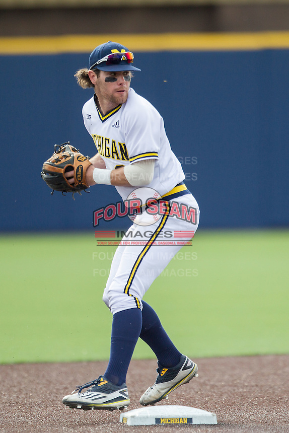 Michigan Wolverines shortstop Michael Brdar (9) attempts to turn a double play against the Toledo Rockets on April 20, 2016 at Ray Fisher Stadium in Ann Arbor, Michigan. Michigan defeated Bowling Green 2-1. (Andrew Woolley/Four Seam Images)