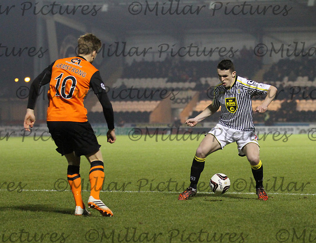 John McGinn being closed down by Stuart Armstrong in the St Mirren v Dundee United Scottish Professional Football League Premiership match played at St Mirren Park, Paisley on 21.1.15.