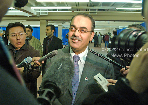Doctor Mahdi S. Abdullah, M.D., of Mount Vernon, New York meets reporters after casting his vote in the Iraqi election in New Carollton, Maryland on January 28, 2005.  Doctor Abdullah, a Baghdad-born internist, fled Iraq in 1993 after several of his relatives were killed by Saddam Hussein's regime.  He expressed joy at voting in the first free Iraqi election during his lifetime...Credit: Ron Sachs , CNP..(RESTRICTION: NO New York or New Jersey Newspapers or newspapers within a 75 mile radius of New York City)