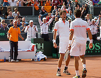 15-09-12, Netherlands, Amsterdam, Tennis, Daviscup Netherlands-Suisse, Doubles, Robin Haase/Jean-Julian Rojer in jubilation in the back captain Jan Siemerink