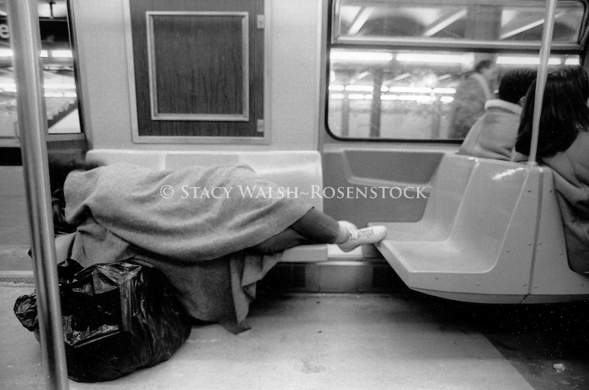 (021207-SWR04.jpg) Hew York, NY - Circa 1990 -  Homeless person asleep on the subway.