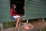 Lorena Ulasso studies in the doorway of her cabin in a residential program for indigenous students in Atalaia do Norte, Brazil. The program, run by an evangelical pastor, hosts indigenous young adults from throughout the Amazon region. Ulasso is a Mayuruna from Soles, Peru.