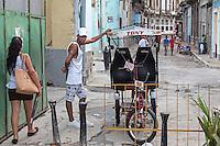 Taxi driver recruiting a passenger, Centro Habana
