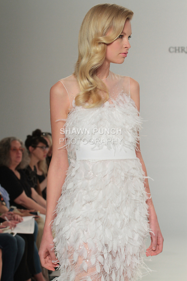 Model walks runway in a feather appliqué column dress, from the Christian Siriano for Kleinfeld bridal collection, at Kleinfeld on April 18, 2016 during New York Bridal Fashion Week Spring Summer 2017.