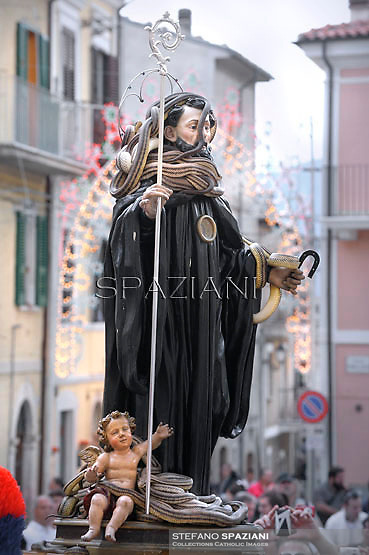 "A statue of Saint Domenico surrounded by live snakes is held up by worshippers during an annual procession dedicated to the saint, in the streets of Cocullo, in the Abruzzo region, on May 1, 2012...The St. Domenico's procession in Cocullo, central Italy. Every year on the first  of May, snakes are placed onto the statue of St. Domenico and then the statue is carried in a procession through the town. St. Domenico is believed to be the patron saint for people who have been bitten by snakes:..Italy, Cocullo, in the Province of L'A...quila, is at 870 meters a.s.l., along the railway line connecting Sulmona to Rome. The village rises alongside Mount Luparo (1327 meters) ""The valley opening in front of the village is surrounded by bare rocks, while on the other side, to the south, snow-capped mountain crests follow one after the other..."".San Domenico Abate lived in the 10th and 11th centuries AD. Born in Foligno, in the Umbria region, he started his pilgrimages, preaching and ascetic practices in Central Italy, making miracles recorded by the word-of-mouth tradition. He died on 22 January 1031 and was buried in Sora...Cocullo snake charmers are over with their snake hunting. They proceeded through the During the procession on the first in May, before the snakes are placed all over the statue of St. Dominick, they will be fed with milk kept in containers with crusca. It is the snake that, most of all other elements, expresses an ancestral myth: the unknown aspect and unpredictability of the natural environment with man's innate need to achieve the dominance on his own habitat. ..Snakes and wolves were the emblems of Italic peoples like the Marsians and Irpinians. Some areas in Abruzzo, especially in the Sagittario valley, were under the menace of wolves and snakes, which for the local populations represented the uncertainty and anxiety of their existence that, together with the precariousness and hardships of life, were almost unbearable. Therefore the community adopted s"
