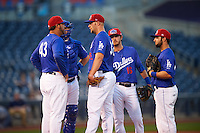 Tulsa Drillers pitching coach Bill Simas (43) talks with starting pitcher Chris Anderson (32) as catcher Kyle Farmer (17), third baseman Brandon Trinkwon (16) and first baseman Tyler Ogle (24) listen in during a game against the Arkansas Travelers on April 25, 2016 at ONEOK Field in Tulsa, Oklahoma.  Tulsa defeated Arkansas 4-3.  (Mike Janes/Four Seam Images)