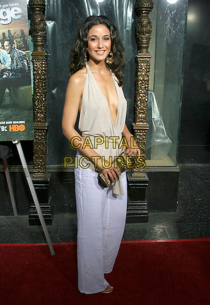 EMMANUELLE CHRIQUI.Premiere of HBO's series ENTOURAGE held at the El Capitan Theater, Hollywood, California.May 25th, 2005.Photo Credit: Zach Lipp/AdMedia.full length white trousers beige halterneck plunging neckline top wrap around clutch purse.www.capitalpictures.com.sales@capitalpictures.com.© Capital Pictures.