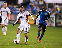 Santa Clara, California -Saturday, March 29, 2014: Lee Nguyen of New England Revolution passes the ball away from Cordell Cato of SJ Earthquakes during a match at Buck Shaw Stadium. Final Score: SJ Earthquakes 1, NE Revolution 2