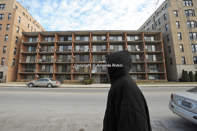 A young man walks down South Jeffrey Boulevard in the South Shore neighborhood of Chicago, Illinois on January 2, 2008.  Michelle Obama, wife of U.S. President Elect Barack Obama, was raised in a modest bungalow in the South Shore neighborhood on the South Side of Chicago.