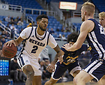 Nevada guard Jalen Harris (2) drives on Colorado Christian's Justin Engesser during the first half of an NCAA college basketball game in Reno, Nev., Wednesday, Oct. 30, 2019.