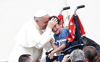 Papa Francesco saluta un bambino durante l'incontro con gli appartenenti al Rinnovamento nello Spirito Santo in Piazza San Pietro, Citta' del Vaticano, 3 luglio 2015.<br /> Pope Francis greets a child during his meeting with members of the Catholic Charismatic Renewal in St. Peter's Square at the Vatican, 3 July 2015.<br /> UPDATE IMAGES PRESS/Isabella Bonotto<br /> <br /> STRICTLY ONLY FOR EDITORIAL USE