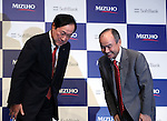 Japan's mega bank Mizuho Financial Group president Yasuhiro Sato (L) and Japanese telecommunication giant Softbank president Masayoshi Son exchange bows at a press conference in Tokyo on Thursday, September 15, 2016. They announced to form a FinTech based joint venture lending service.   (Photo by Yoshio Tsunoda/AFLO) LWX -ytd-