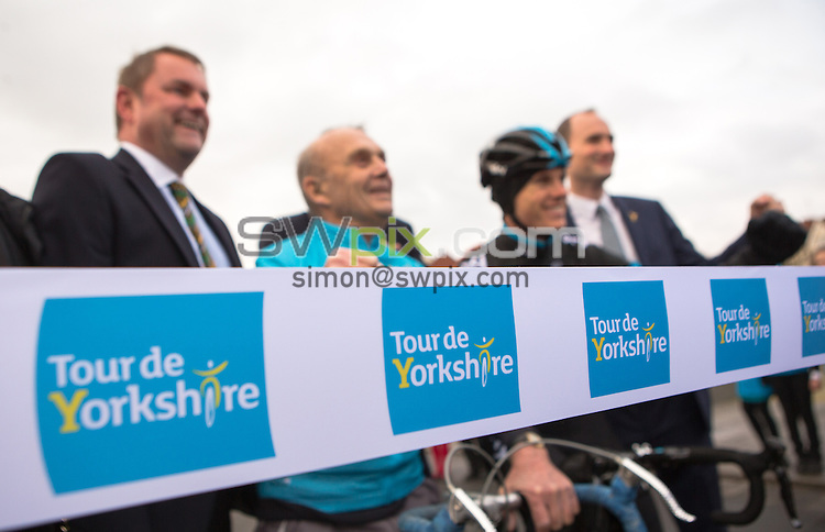 Picture by Alex Whitehead/SWpix.com - 21/01/2015 - Cycling - Tour de Yorkshire 2015 Route Launch - The Spa, Bridlington, England - (from left) Welcome to Yorkshire Chief Executive Gary Verity, former cyclist Brian Robinson, Team Sky cyclist Ben Swift and Jean-Etienne Amaury of ASO pictured with local school children to launch the route of the 2015 Tour de Yorkshire.