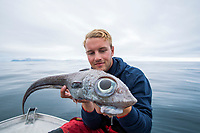BNPS.co.uk (01202 558833)<br /> JørgenZwilgmeyer/BNPS<br /> <br /> Oscar Lundahl with the fish.<br /> <br /> A fisherman got the shock of his life when he accidentally reeled in this googly-eyed monster from the deep.<br /> <br /> Oscar Lundahl nearly jumped out of his fishing boat when he saw the bizarre-looking species with bulbous eyes on the end of his hook.<br /> <br /> The specimen is in actual fact a ratfish, whose Latin name Chimaeras Monstrosa Linnaeus is derived from a Greek mythical monster that had the head head of a lion and tail of a dragon.<br /> <br /> Oscar caught it in deep water while fishing off Norway.