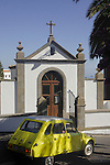 Yellow citroen car passing a Chapel in San Miguel,Tenerife, Canary Islands