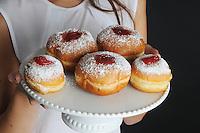 Hanukkah - woman with Doughnuts Hanukkah - donuts