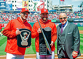 Washington Nationals starting pitcher Max Scherzer (31), left, holds the 2017 Cy Young Award; Washington Nationals second baseman Daniel Murphy (20), center, holds his 2017 Silver Slugger award, as they pose for a photo with Mike Rizzo, general manager and president of baseball operations of the Washington Nationals, prior to the game against the New York Mets at Nationals Park in Washington, D.C. on Thursday, April 5, 2018.  The Mets won the game 8-2.<br /> Credit: Ron Sachs / CNP<br /> (RESTRICTION: NO New York or New Jersey Newspapers or newspapers within a 75 mile radius of New York City)