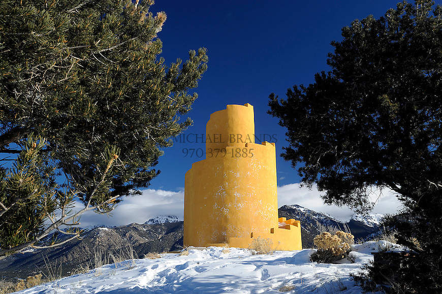 A prayer tower called a Ziggurat is a colorful mark on the foothills of the Sangre de Cristo mountain range near Crestone, CO.